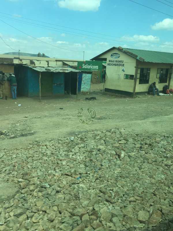 Kenya village street shacks and frail houses in Africa