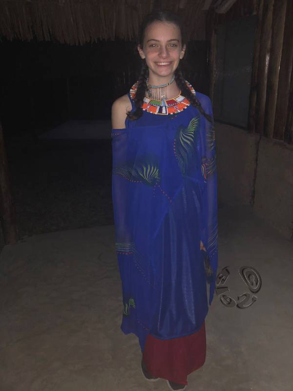 Maya in African dress ready to volunteer